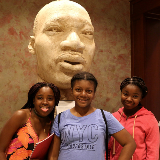 Scholars proudly stand in front of Dr. Martin Luther King's statue.jpg