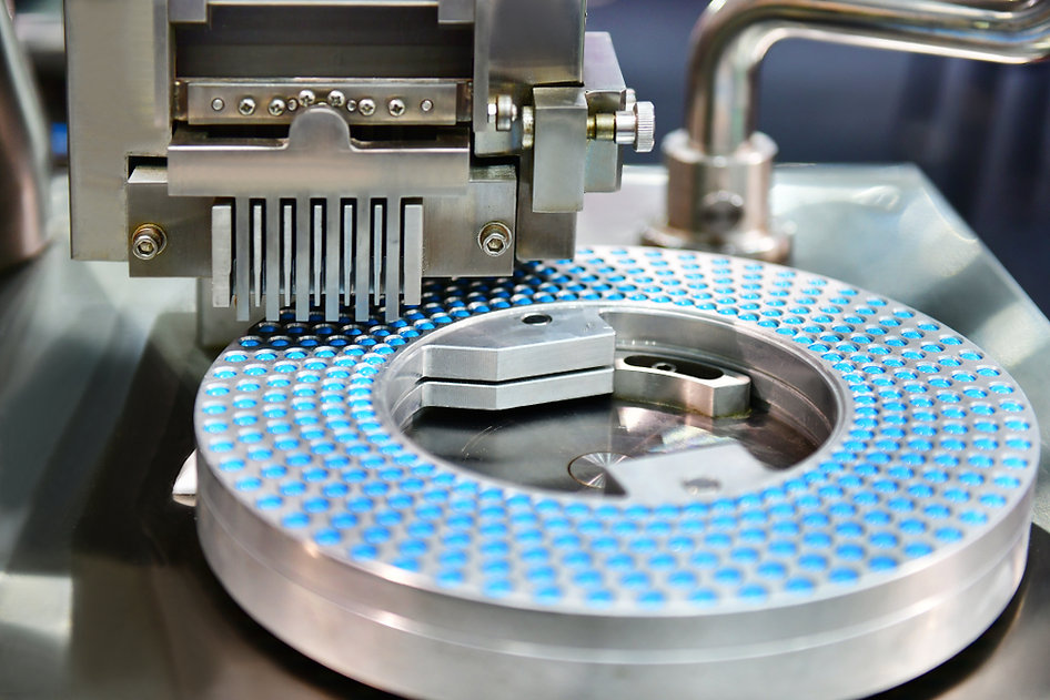 Blue capsule medicine pill production line, Industrial pharmaceutical concept..jpg