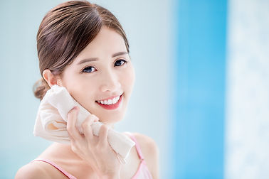 beauty asian girl clean her face with towel in the bathroom.jpg