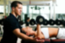 bigstock-Personal-Trainer-in-gym-9671810