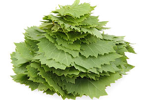 stack of grape leaves isolated on white