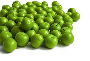 green sour plums in plate, wonderful fre