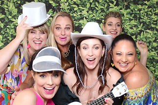 A group of ladies posing with props in Booth Chic Brisbane Photo Booth