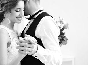 Beautiful wedding couple dancing indoor_edited.jpg