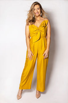 Celebrant wearing mustard gold jumpsuit