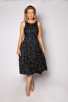 Celebrant wearing black dress with spots