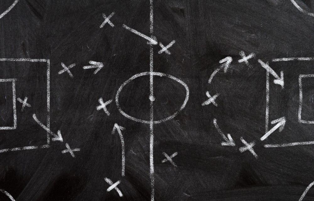 A chalkboard soccer game plan showing what the next steps might be. Those with Empathy use their ability to sense the emotional flow to anticipate the next move.