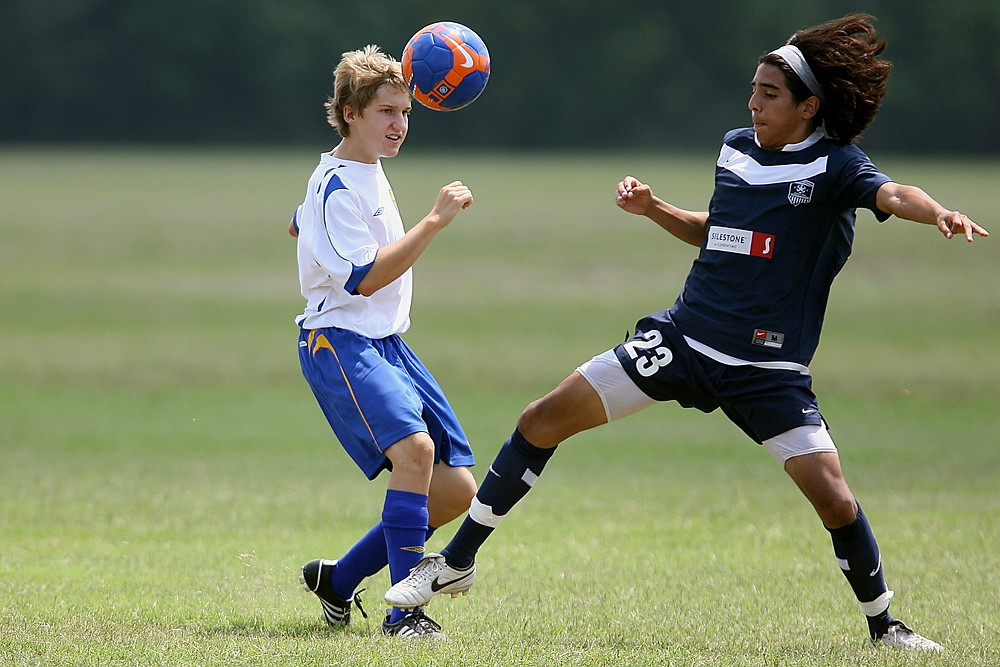 A soccer player challenging for the ball; the same way those with Command talents will challenge others to stand up or stand aside.