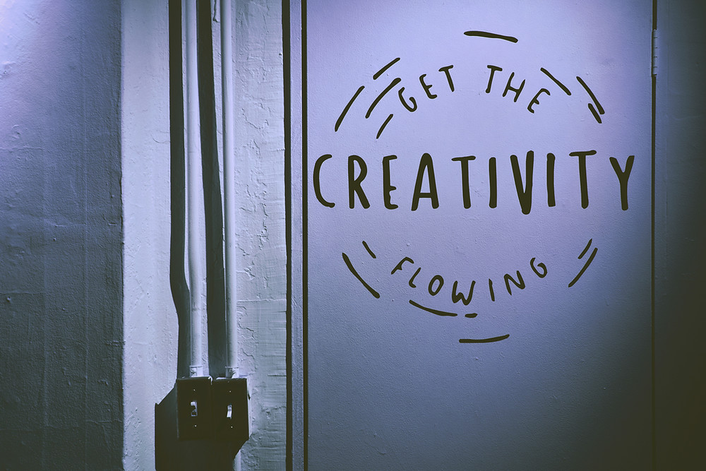"""wall art that says """"get the creativity flowing""""; something one might paint on the inside of a soccer locker room if the team was full of players with CliftonStrengths Ideation talents."""