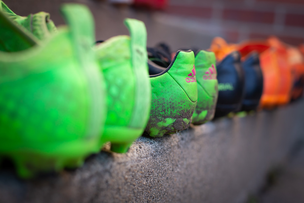 a line of different soccer cleats, representing the unique differences among work team colleagues.