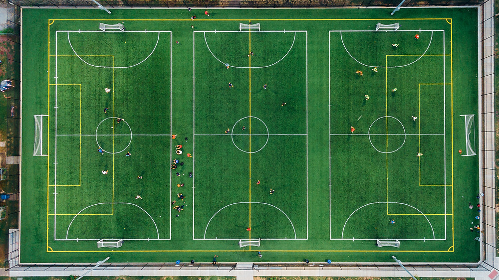 A bird's eye view of soccer fields as an analogy for the blueprints of soccer; just as those with Context love to understand the blueprints of a business.
