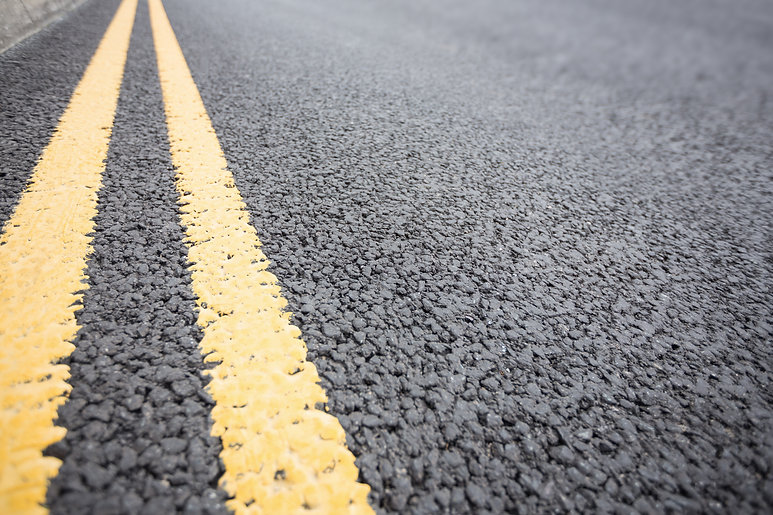 yellow-road-marking-road-surface.jpg