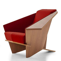 Interesting wooden chair with red seat cushion.