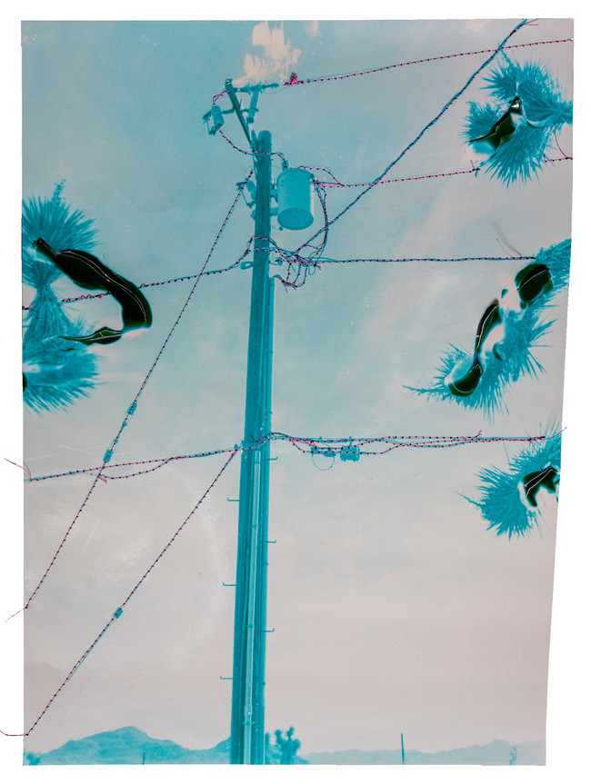 Blue power line with punctured sky, 2021  Chemically altered chromogenic photograph accentuated with thread  14 x 11 ins (35.56 x 27.94 cms)