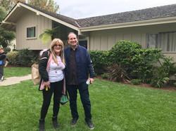 Susan Olsen in front of House Brady Bunc