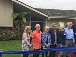 Brady Bunch all 6 in front of house 5-23