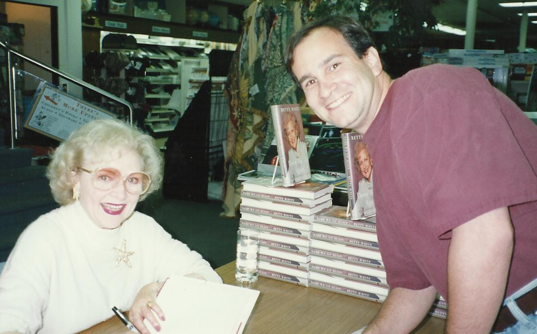 Betty White Book signing at desk