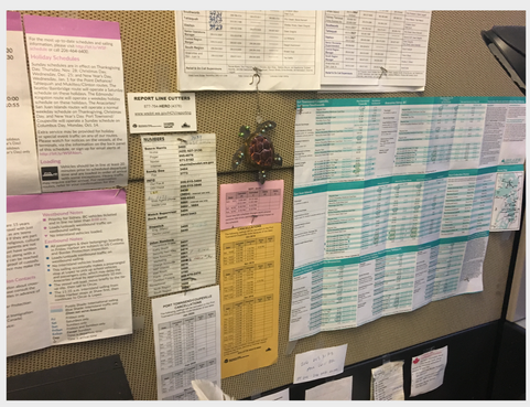 Call Center cubicle wall with schedules and routes