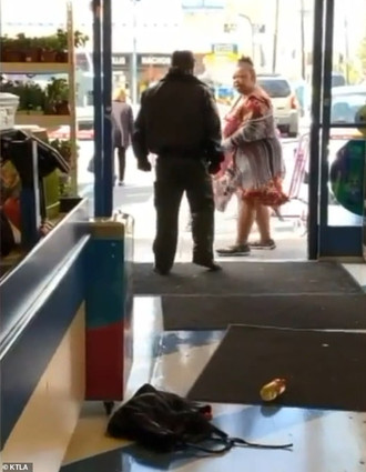 Dollar Store Security Officer Maces and Punches Woman in the Face After She's Accused of Shoplif