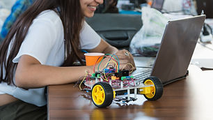 Students code a metal car robot and an e
