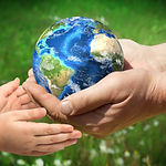The man gives planet Earth to baby. Ecol