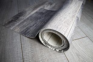 Roll of linoleum with a wood texture. Linoleum cutting. Floor coverings..jpg