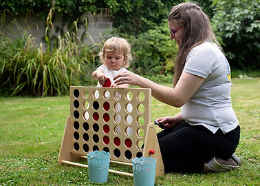 bridesmaid and nanny playing with connect four.jpg