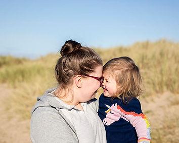 Mum and child happy at beach.jpg