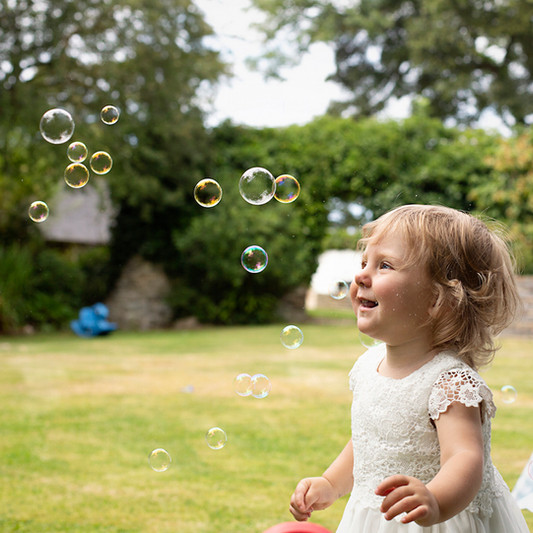 bridesmaid playing with bubbles.jpg