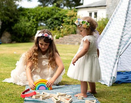bridesmaids playing wearing flower crowns_edited.jpg