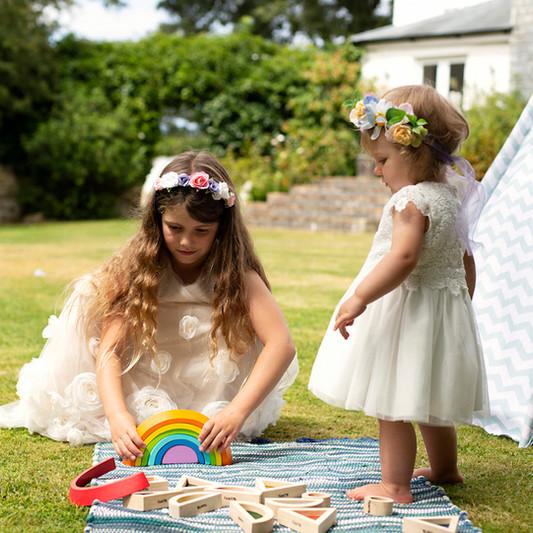 bridesmaids playing wearing flower crowns.jpg