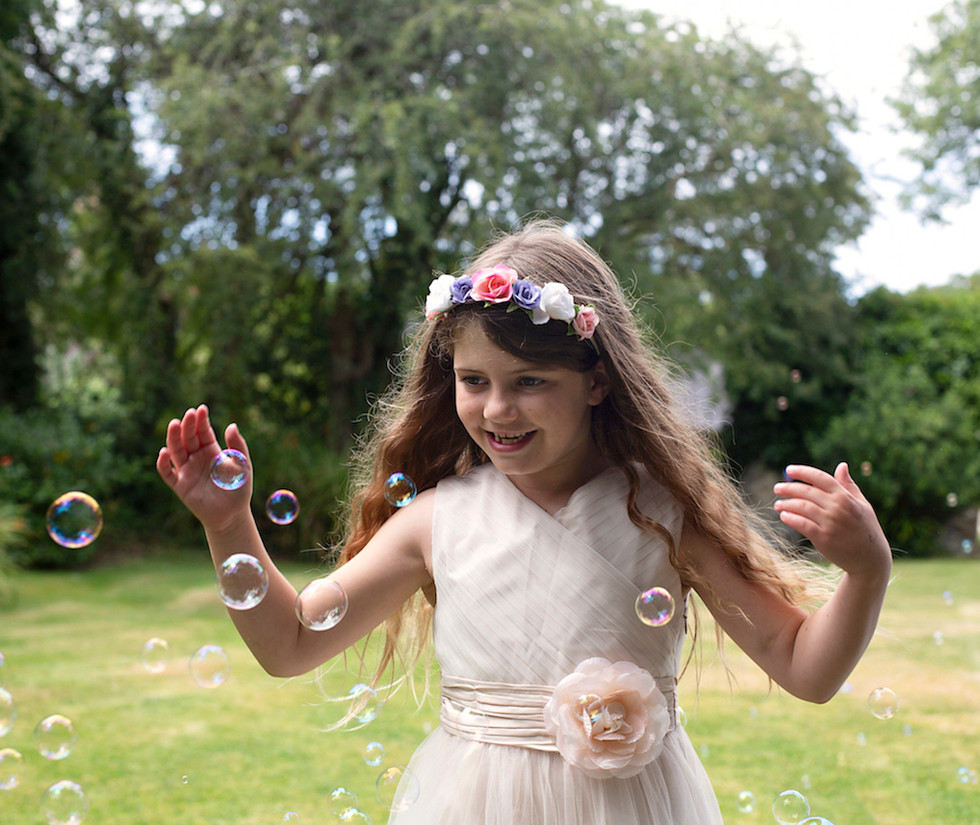 older bridesmaid playing with bubbles.jpg