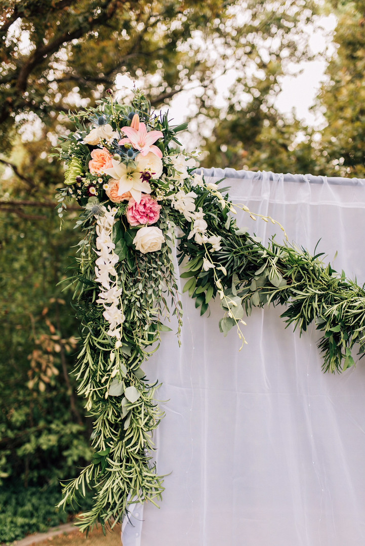 Garland Backdrop with floral inserts