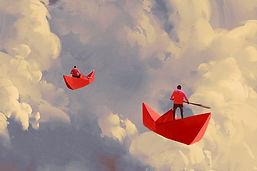 Papier Boote in den Wolken