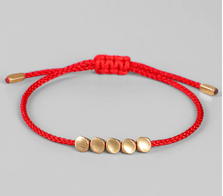 Dainty red rope bracelet with gold bead detailing