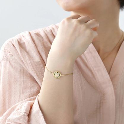 Cute gold tone coin bracelet