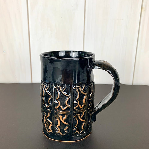 Mug tall black with the beauty of the raw clay showing