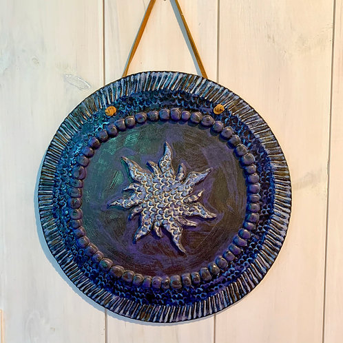 Wall piece - covered in blue & purple.