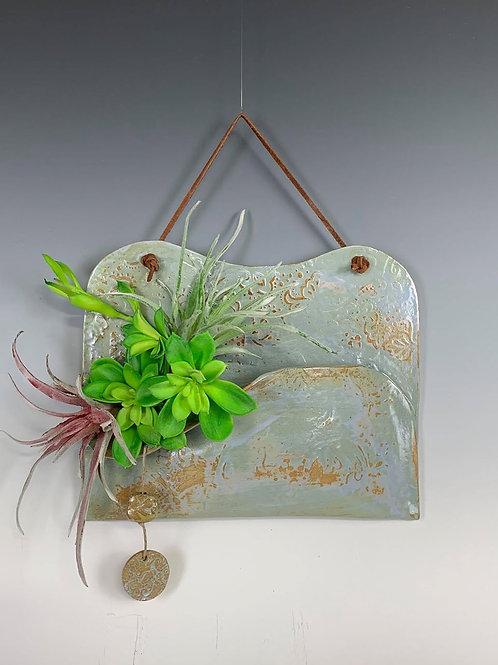 Wall Pocket, beautiful way to display succulents.