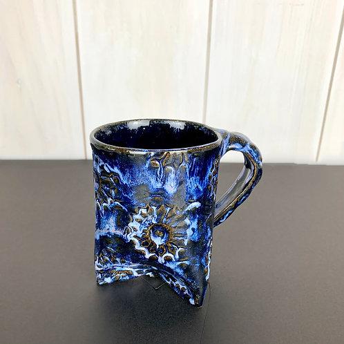 Mug tripod sunflowers in drippy blue hues