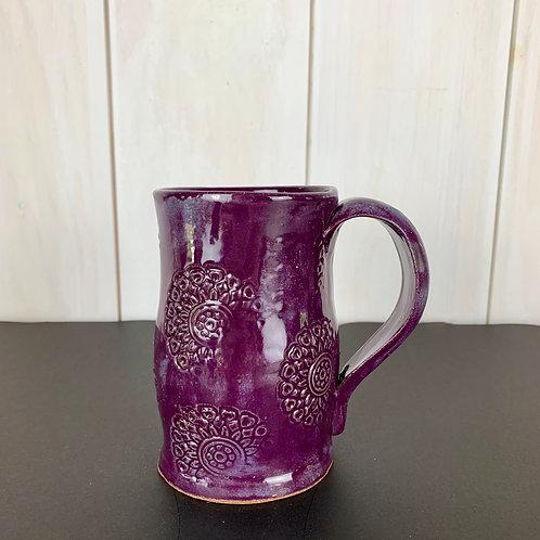 Mug tall and deep purple with medallion design