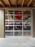 STAND ON LIQUID WINDOW LETTERING