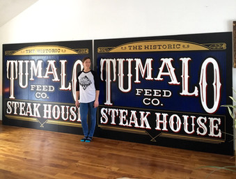 Tumalo Feed Co Signs and Janessa.JPG