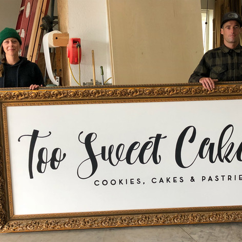 TOO SWEET CAKES BEND- CUSTOME GOLD FRAME AND LOGO SIGN- ARTISTS JANESSA BORK & JOSH RAMP