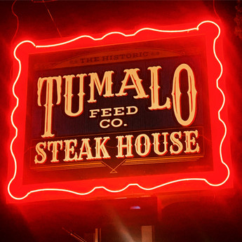 Tumalo Feed Co Road Sign and Neon.JPG