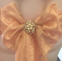 Blush pink sashes with brooch