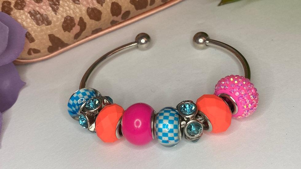 Kolor Me Bad Charm Bracelet