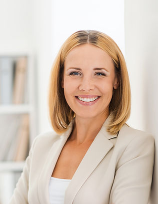Woman Smiling in Suit