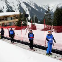 Ski Week veterans on magic carpet