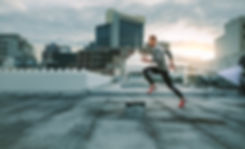 Side view of a fitness man running on ro